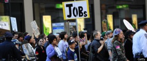 Protester holds a sign that reads Jobs